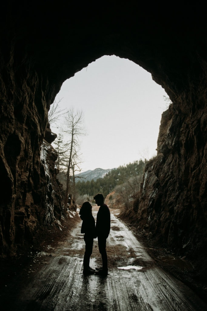 couple standing in a cave in colorado