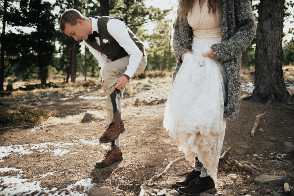 A bride and groom showing off their llama socks on their wedding day in southwest Colorado. Wedding photos after their intimate southwest Colorado ceremony in Westcliffe, Colorado.