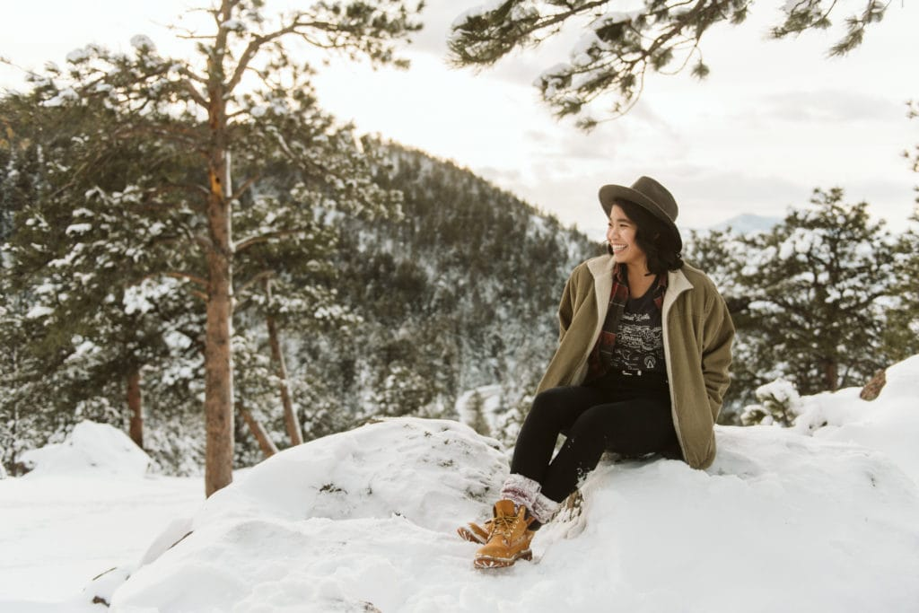 girl in the snow in colorado overlooking the mountains