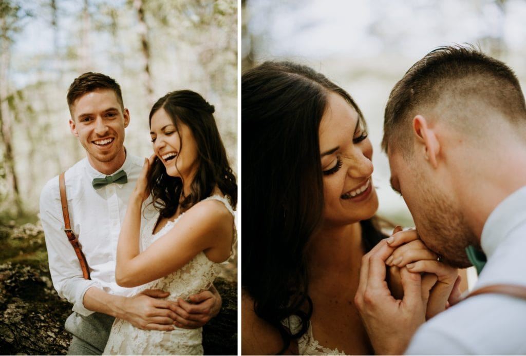 A bride and groom are leaning against a fallen tree and laughing in the forest in Bloomington, Indiana at the Wilds Venue near Brown County State Park.