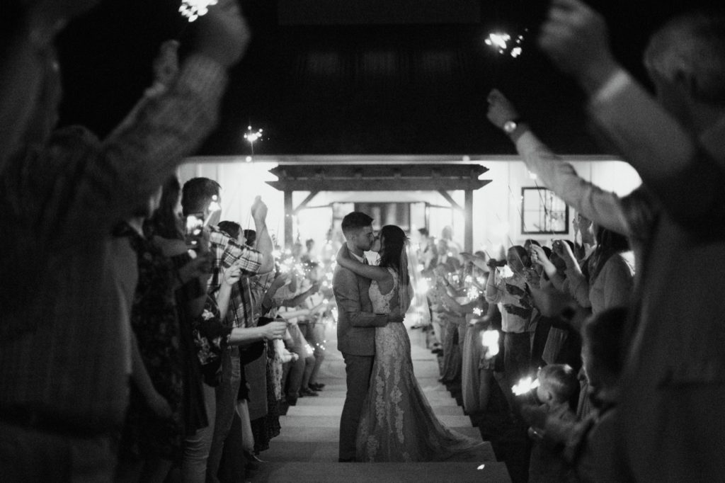 Black and white sparkler exit after an emotional and beautiful intimate wedding ceremony in Bloomington.