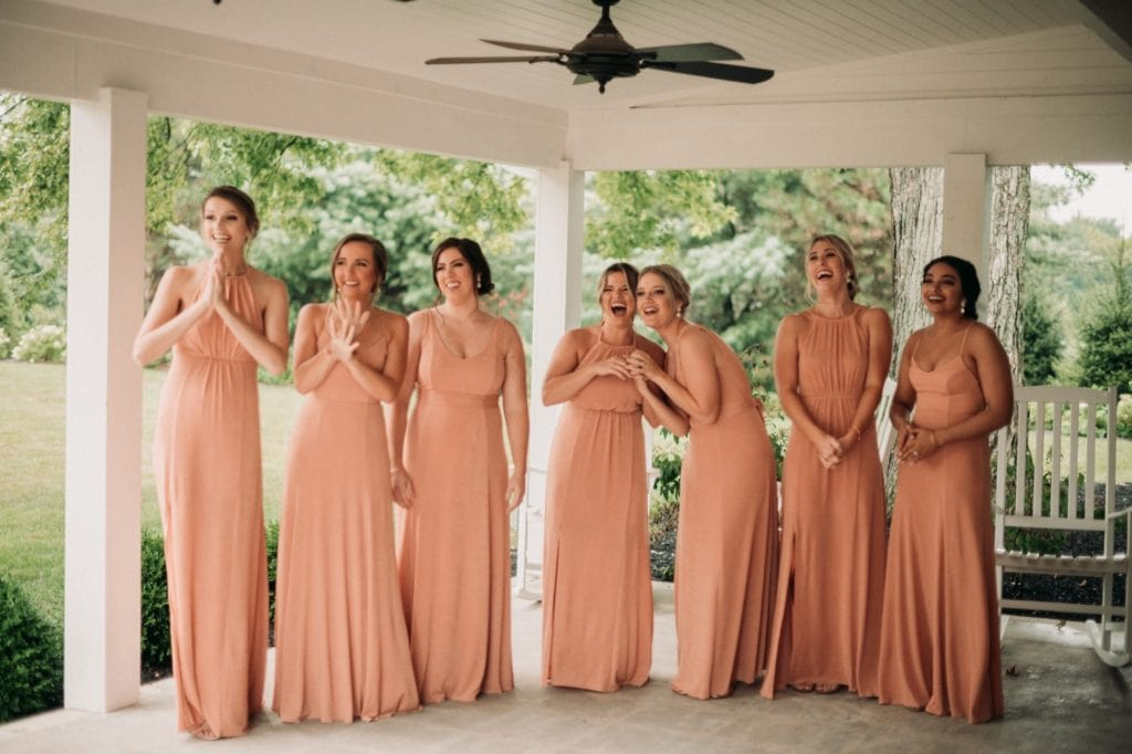 Bridesmaids reactions to seeing the bride for the first time before the wedding ceremony.