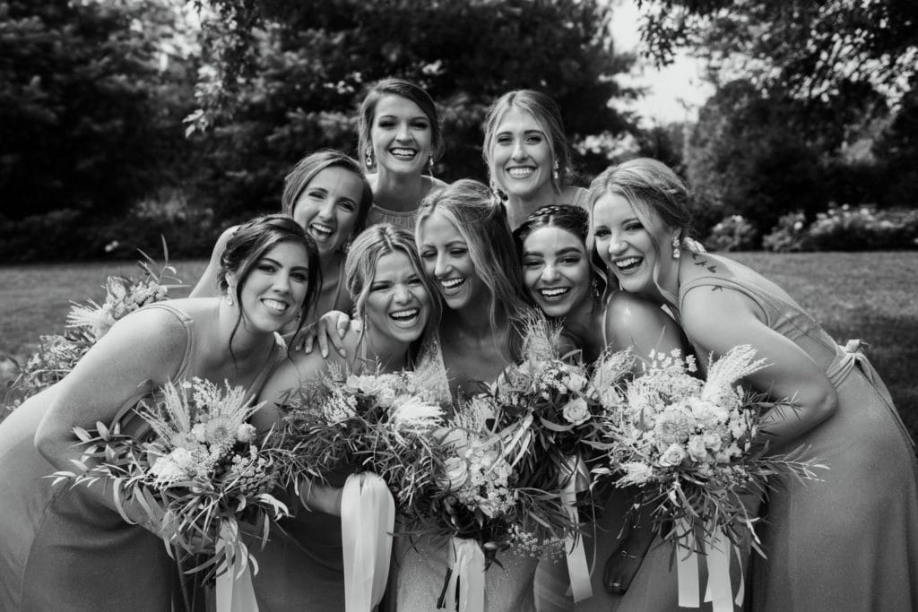 Summer bridesmaids photos in peachy colored dresses at Mustard Seed Gardens.