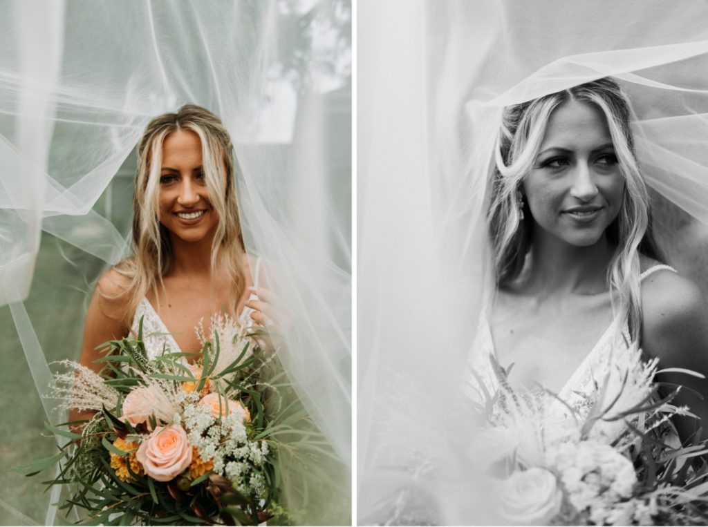 Bohemian bridal portraits under the veil. The bride is in the middle of the frame, holding her bouquet and smiling before the wedding ceremony at Mustard Seed Gardens.