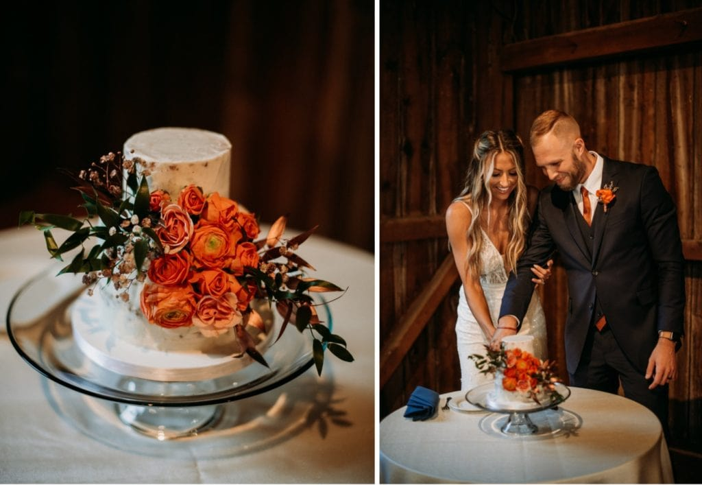 Bride and groom cutting the cake at their reception in the barn at Mustard Seed Gardens