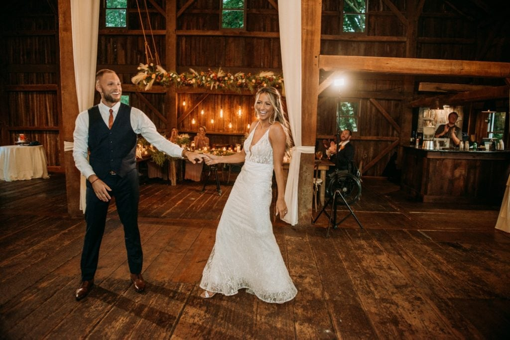 Bride and groom dancing to their choreographed first dance at their wedding reception