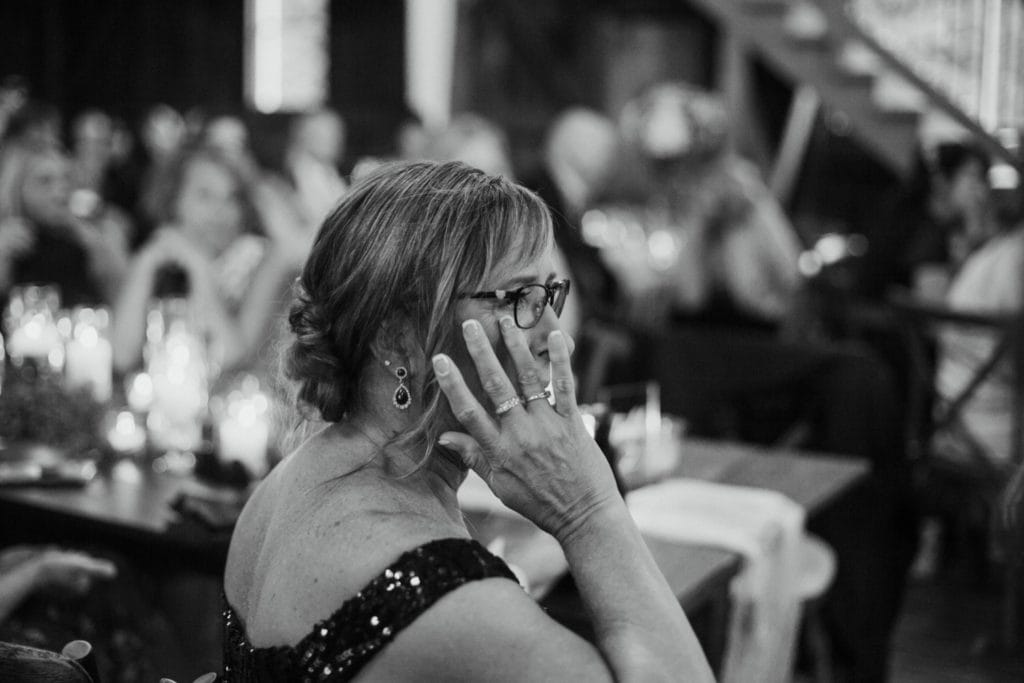 Mother of the bride crying during the first dances at their Mustard Seed Gardens reception