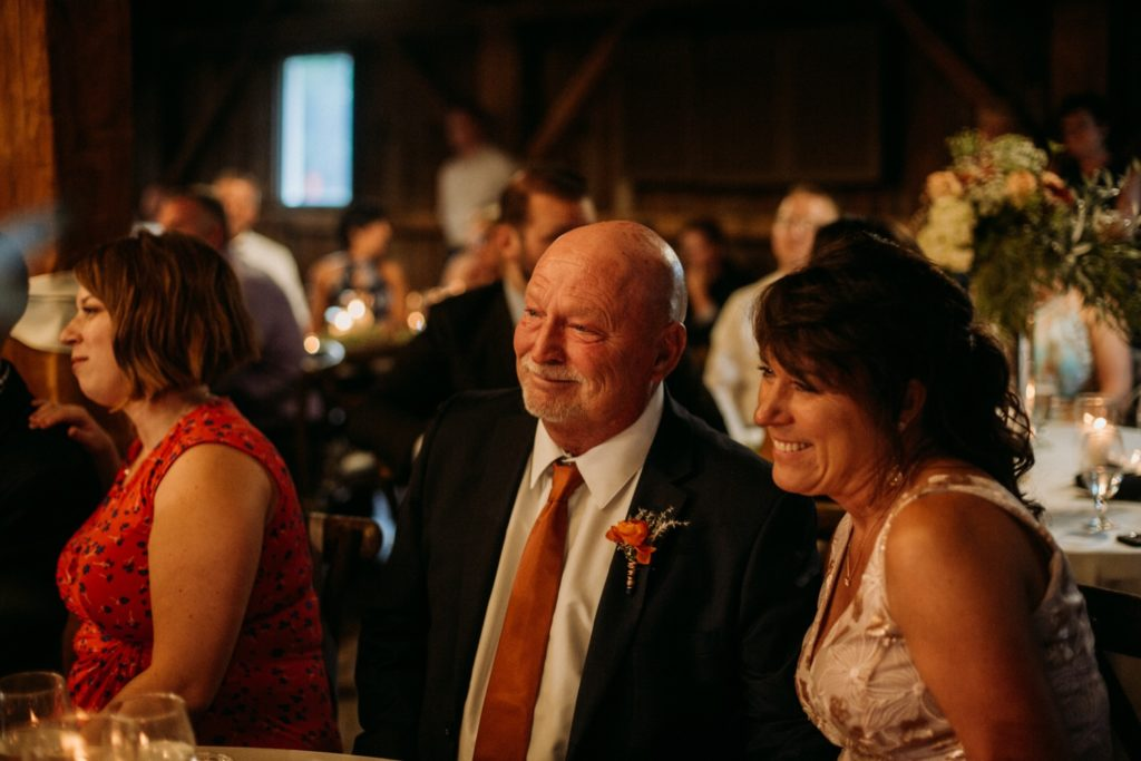 Parents smiling watching the first dances at Mustard Seed Gardens