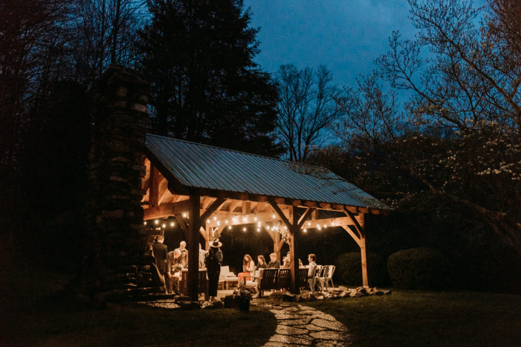 Intimate wedding reception on a covered patio outside the Airbnb wedding location