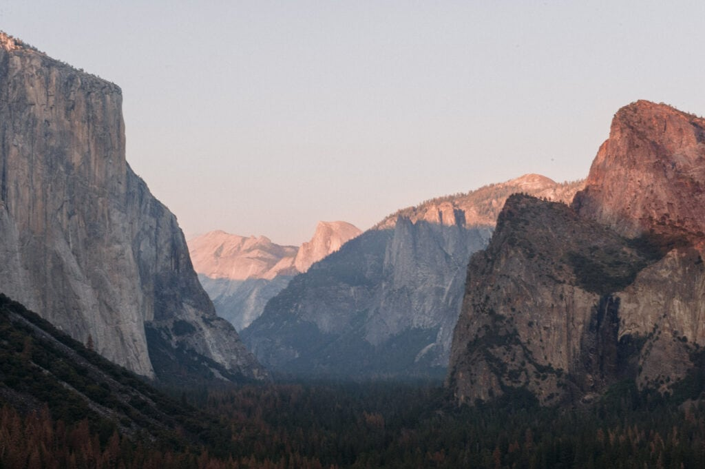 alpenglow hitting the top of half dome in yosemite national park