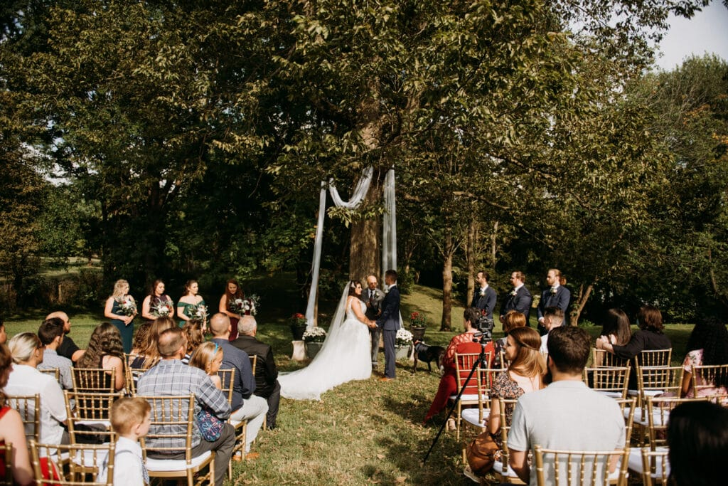 emotional fall backyard wedding ceremony under a tree