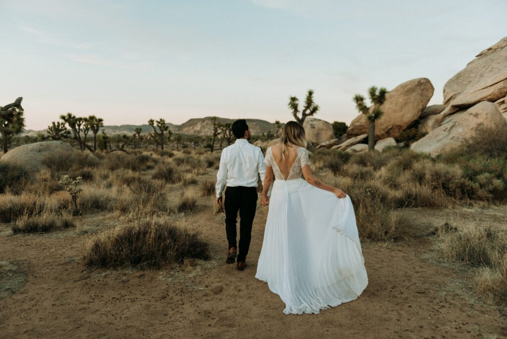 couple walking away during their elopement in joshua tree national park